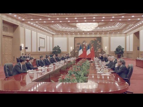 macron meets with xi as china france seal