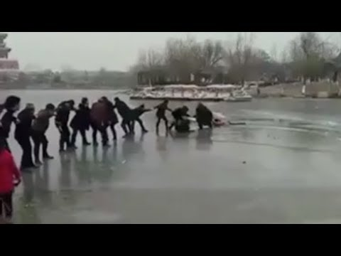 human 'chain' rescues tourists from ice hole