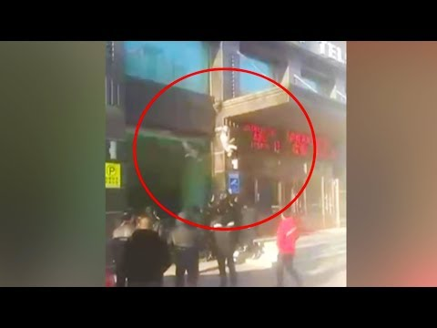 a woman fell off from the building twice