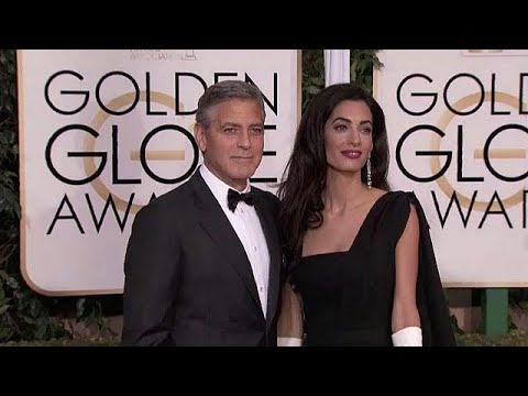 شاهد جورج كلوني وزوجته يتبرعان بنصف مليون دولار للناجين من حادث باركلاند