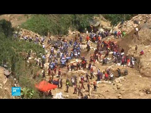 شاهد البحث عن ضحايا انهيار أرضي جراء الإعصار مانغخوت في الفيليبين