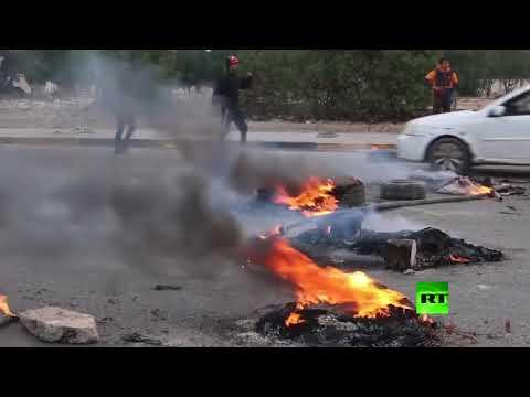 شاهد متظاهرون يغلقون الطرقات في بغداد والبصرة