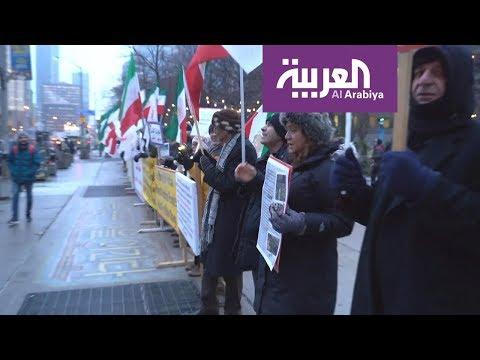 شاهدأهالي ضحايا الطائرة المنكوبة يرفضون وضع العلم الإيراني على الجنازات