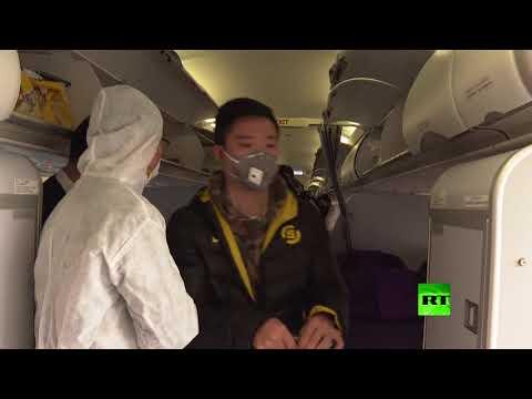 شاهد مطارات الصين تخضع المسافرين للفحص الحراري