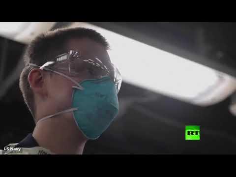 شاهد بحارة أميركيون يخضعون لاختبار كورونا على متن حاملة الطائرات