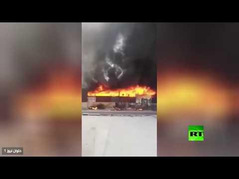 شاهد جهود مضنية لإخماد حريق هائل نشب في سوقًا بـحلوان المصرية