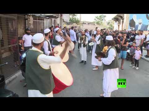 شاهد مراسم جنازة طفلين لبنانيين ماتا من الجوع في البحر المتوسط