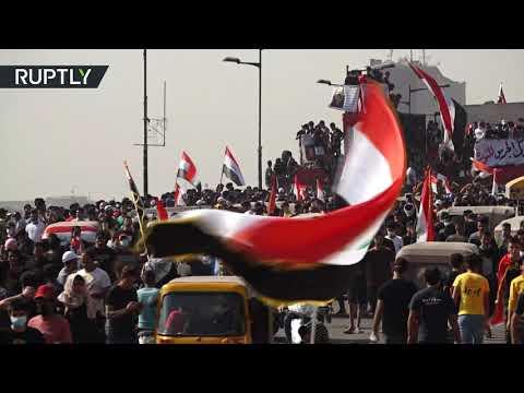 شاهد آلاف العراقيين يحيون الذكرى الأولى لـانتفاض تشرين في بغداد